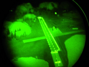 Fig. 4: Illuminated runway from the air seen through image intensifier goggles. (Comment: Photo taken at the Night Vision Training System of the Königsbrück Aviation Physiology Training Center)