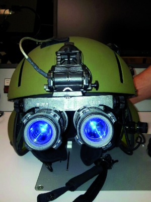 Fig. 5: Conventional image intensifier goggles; (a) mounted on the flight helmet,